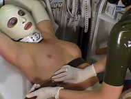 Medical room, two hot women, rubber, hoods, bondage, strap on, sex