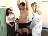 Henry Lemming thought all he'd have to do was to see a doctor and have his ears examined in order to get a generous payoff from his employer. But he's quickly discovering his domineering lawyer Regina has other ideas and orders a full ass exam where he has to bend over naked on the floor with his hole being examined.